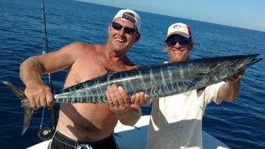 Big Fish SGI Offshore Charter - Happy Angler Holding Wahoo