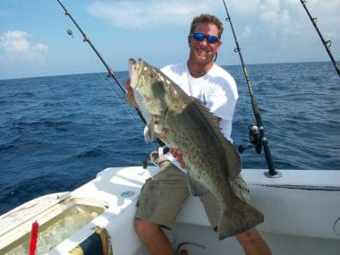 Captain Clint from Big Fish SGI holding Grouper